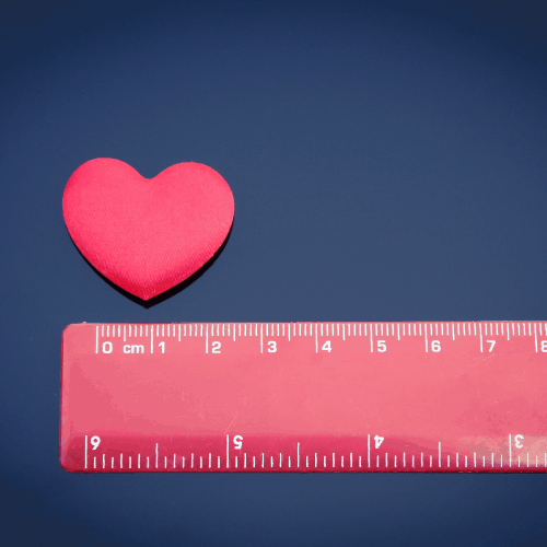 A red love heart next to a red ruler