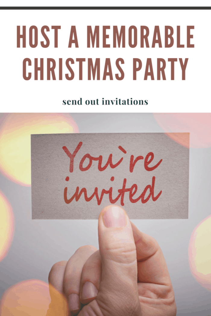 hand holding you're invited card