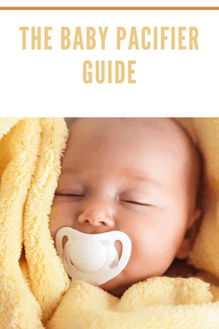 baby with pacifier in yellow towel