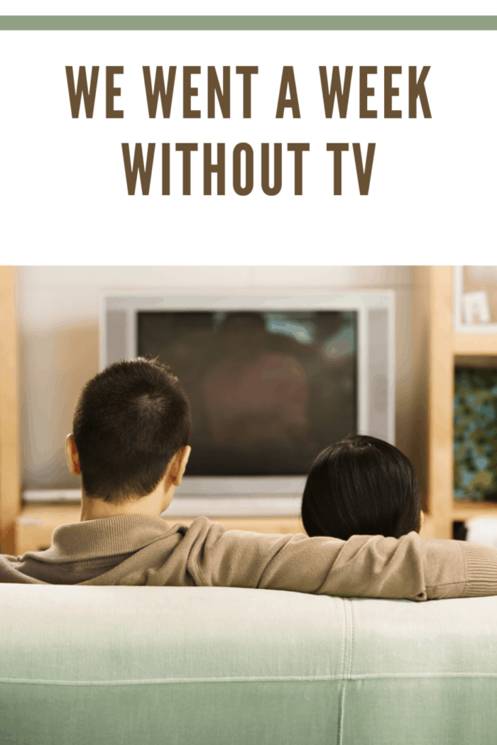 fahter and son in front of tv that's off