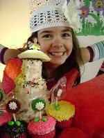 girl with cake made with chef tools three tier magic pans
