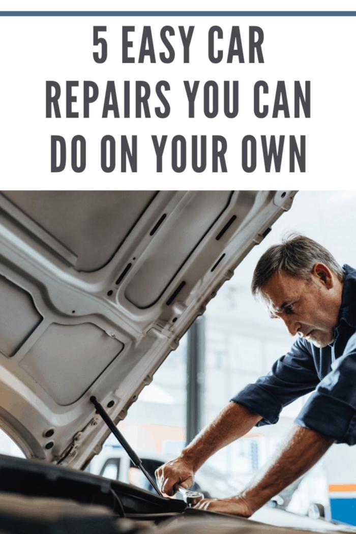 man doing car repair