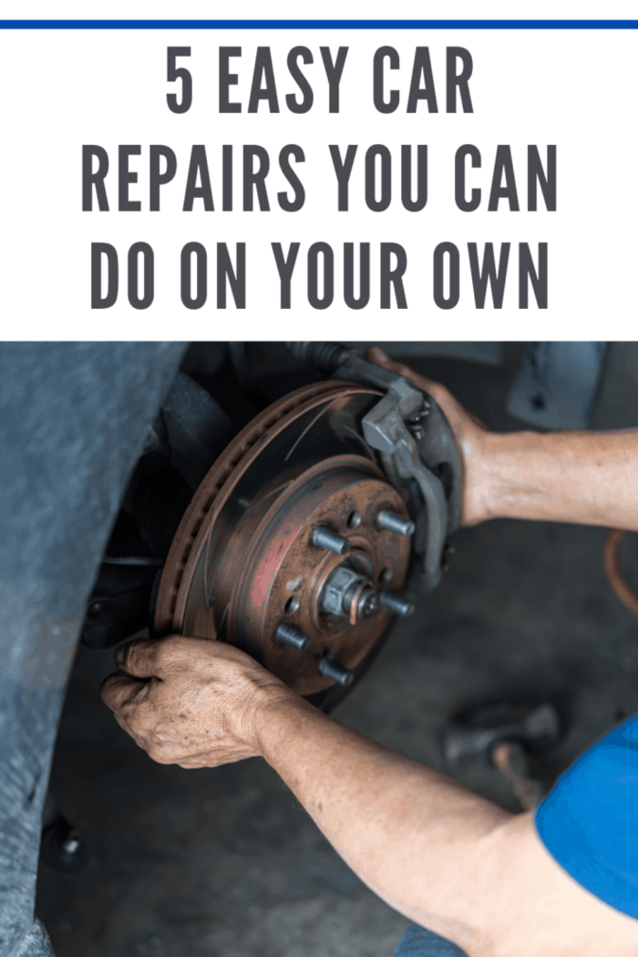 man changing brake pads