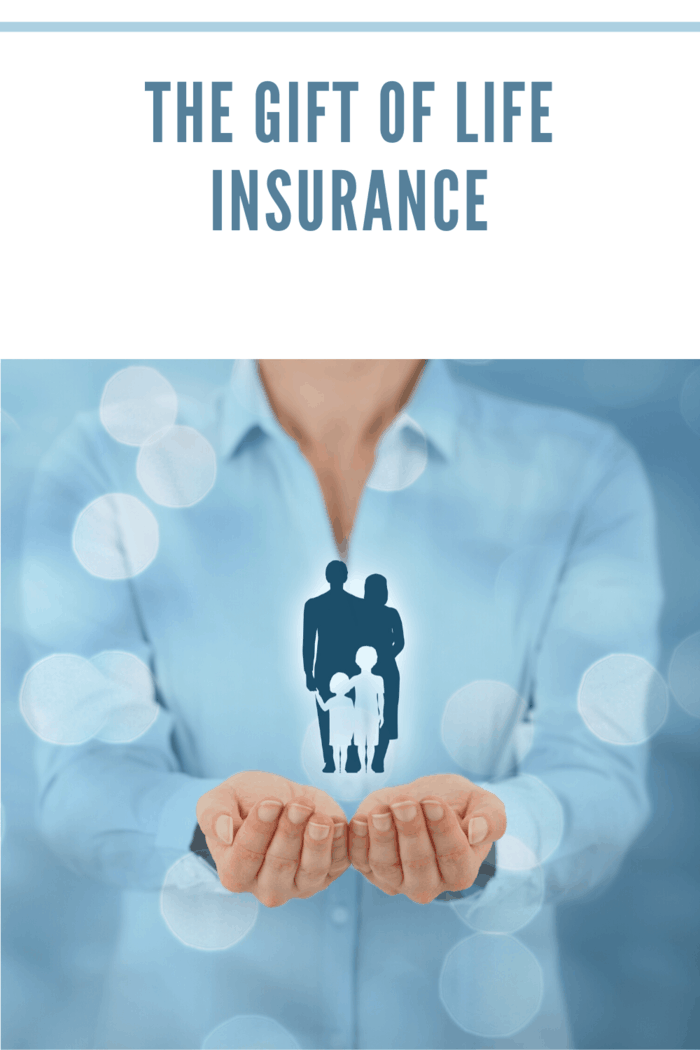 life insurance represented by woman holding family in hands