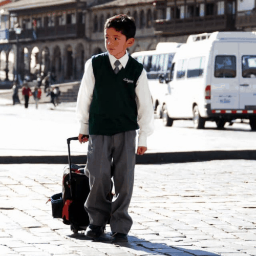 child in front of private school