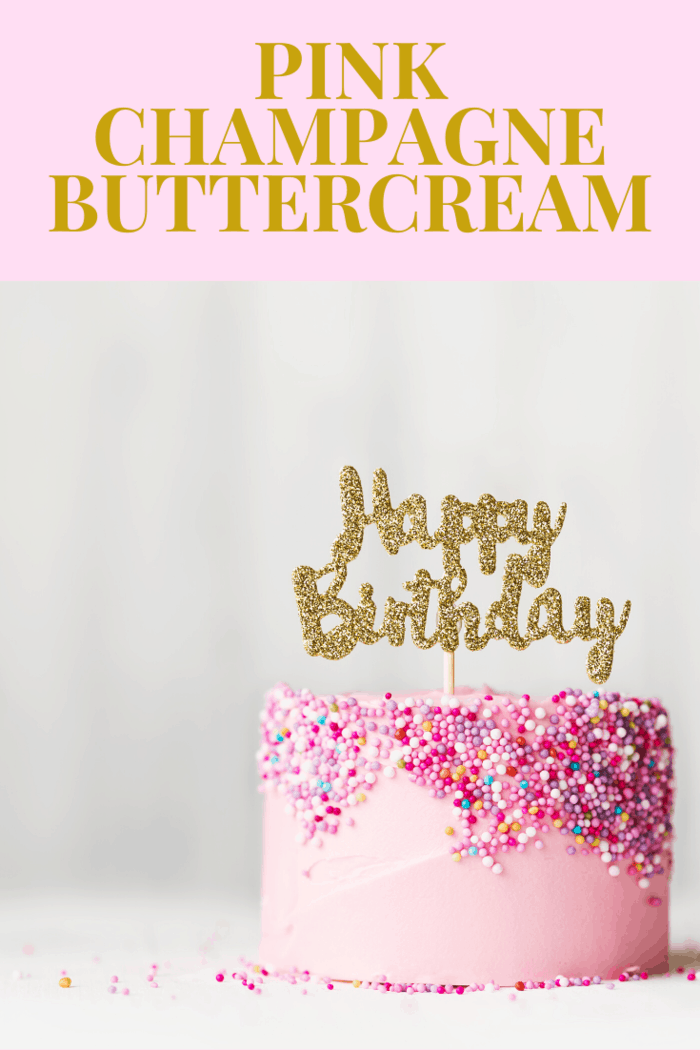 pink champagne bruttercream iced Happy Birthday Cake with lots of pink sprinkles