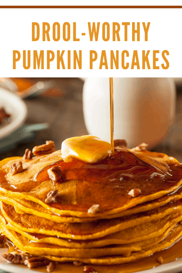 Pumpkin pancake s stacked and topped with butter and drizzling with maple syrup.