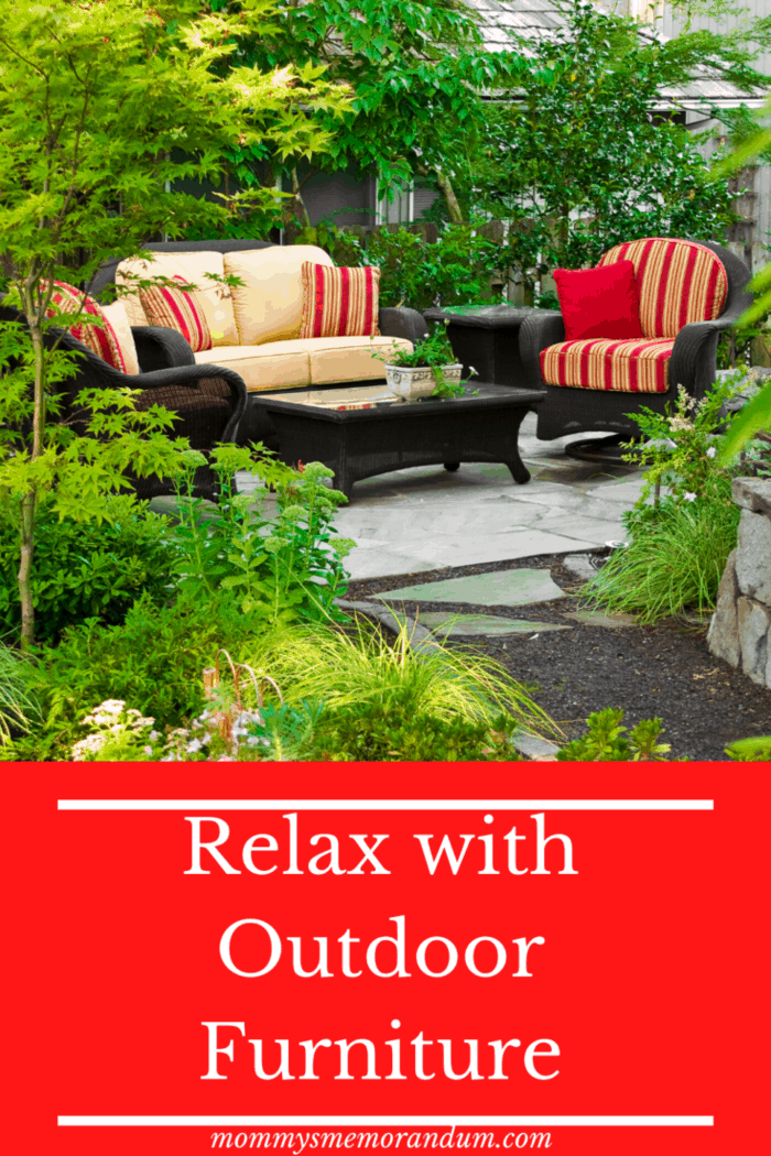 red and beige outdoor furniture on garden patio
