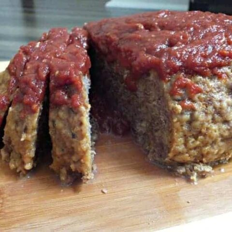 Delicious Instant Pot easy meatloaf recipe. Enjoy a traditional meatloaf recipe in half the time when cooked in your Instant Pot. It's topped with ooey gooey goodness your family will love.