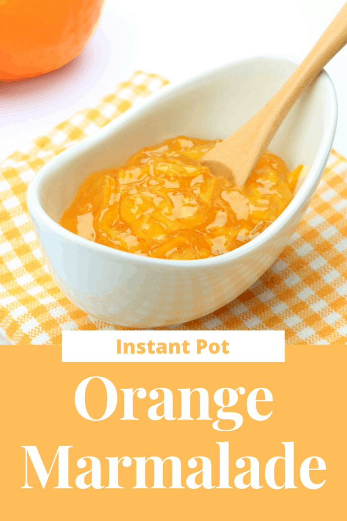 instant pot orange marmalade in dish with spoon ready to eat