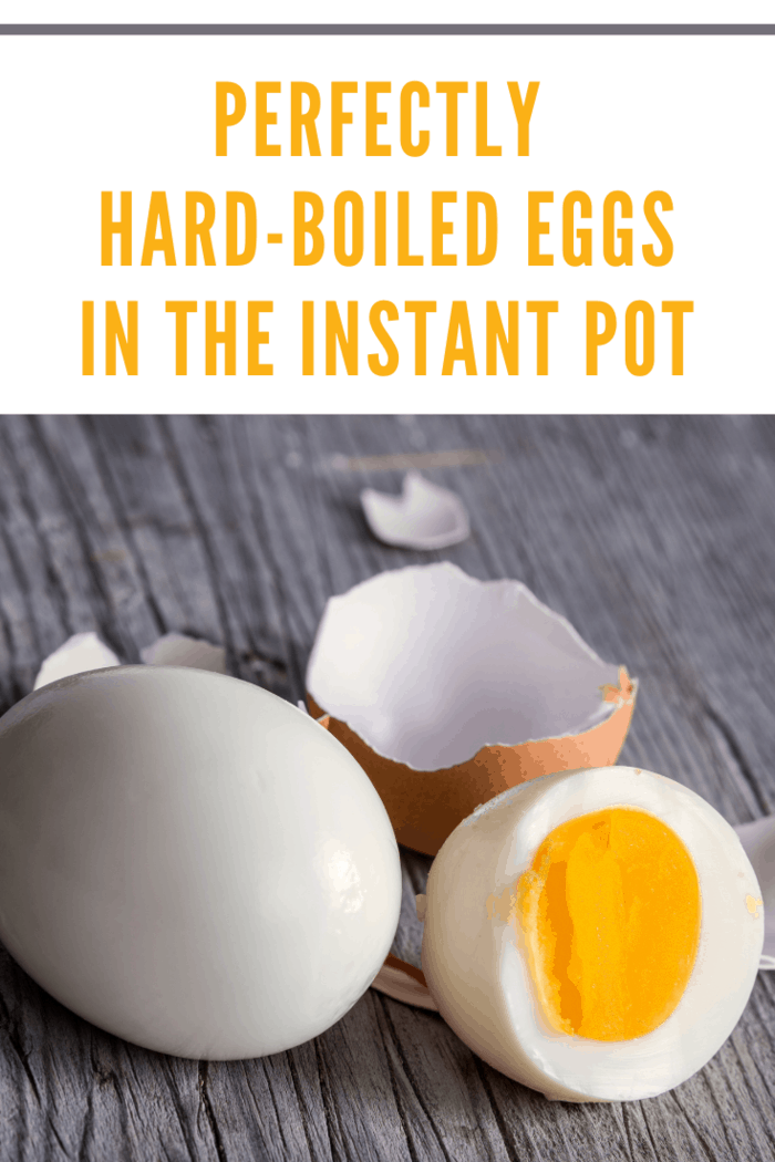 Sliced instant pot hard boiled eggs using 5-5-5- method on wooden cutting board
