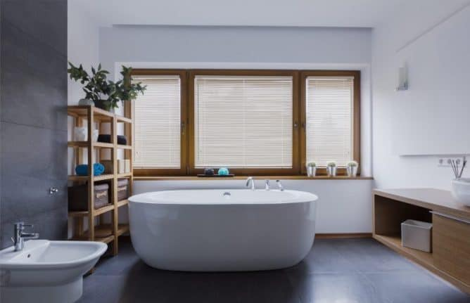 Spacious and comfortable bathroom with freestanding bathtub and the right blinds for your bathroom