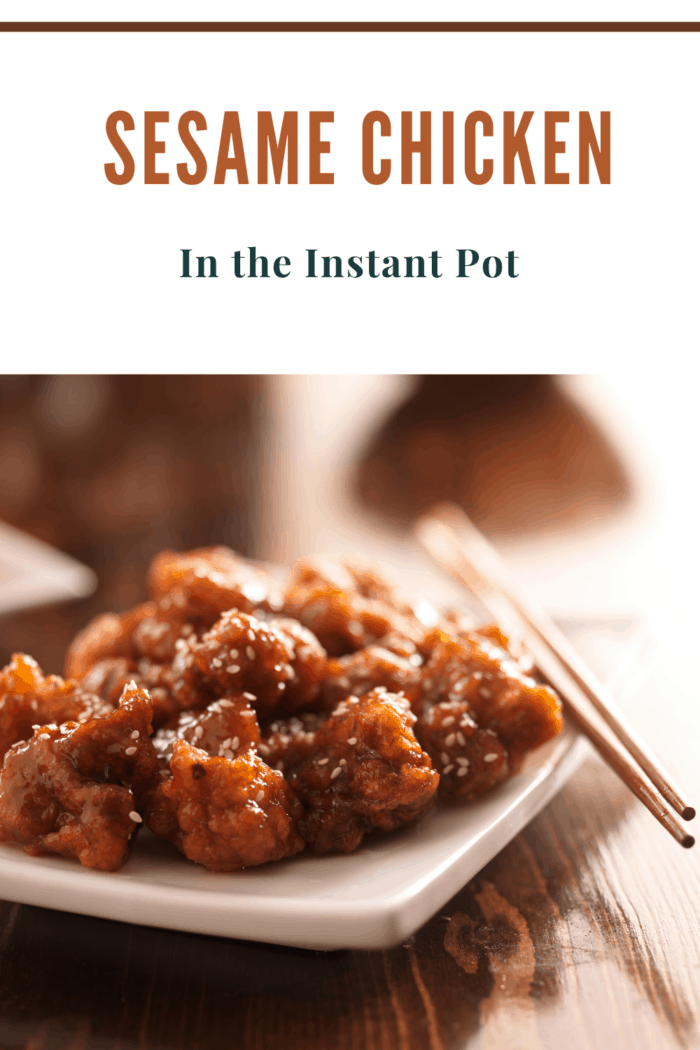 instant pot sesame chicken on plate with chopsticks