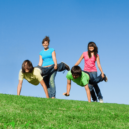 diverse group of active healthy teens playing wheelbarrow race outdoors at summer camp Click here to see more AA''Groups - happy smiling people''AAimages