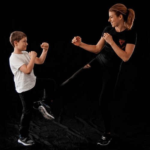 mother and son kickboxing