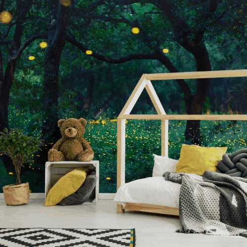 room with outdoor mural at dusk with fireflies and tree silhouettes