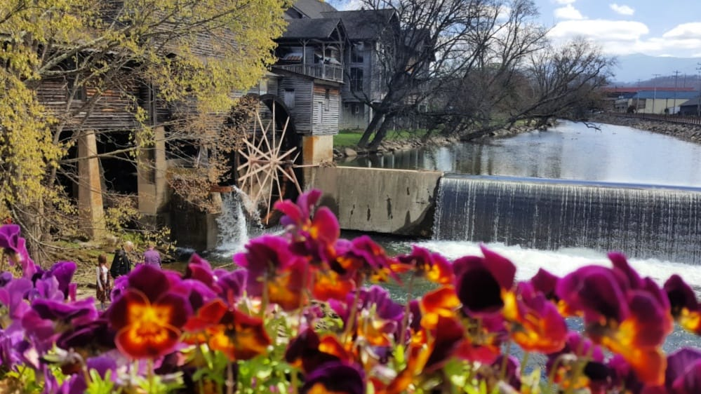 old mill with flowers pigeon forge