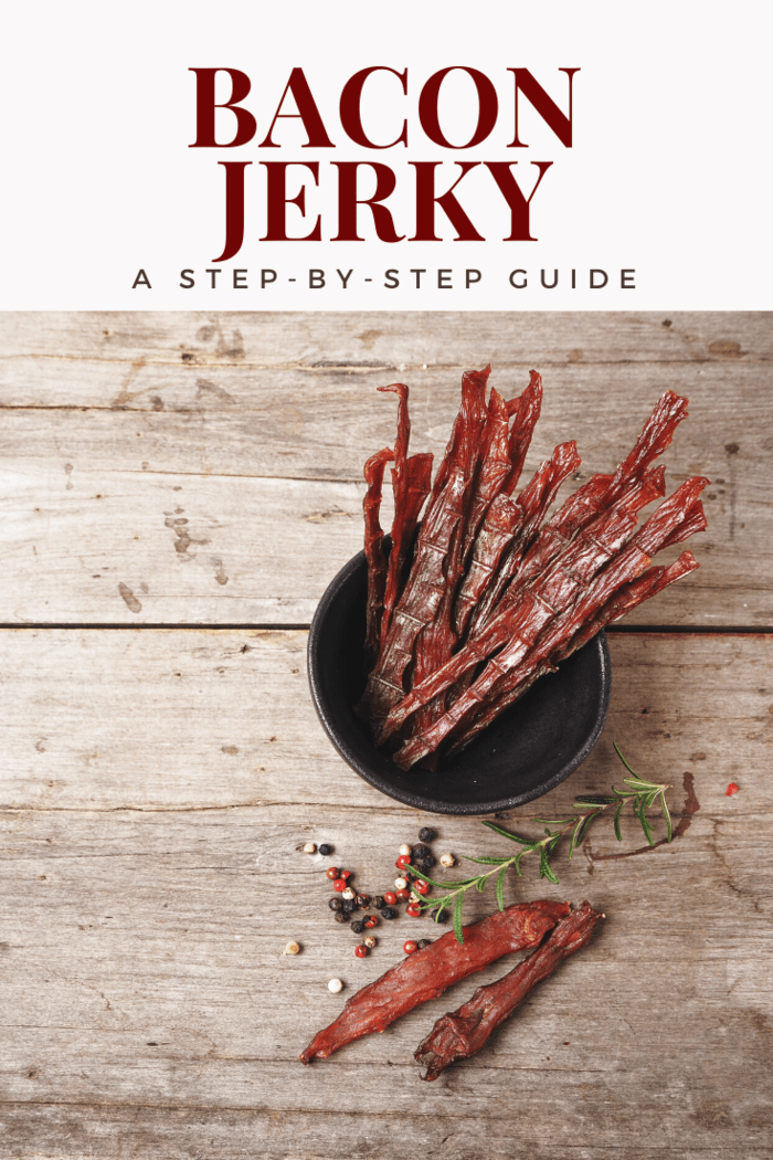 bacon jerkey in a bowl with herbs and spices on wood table