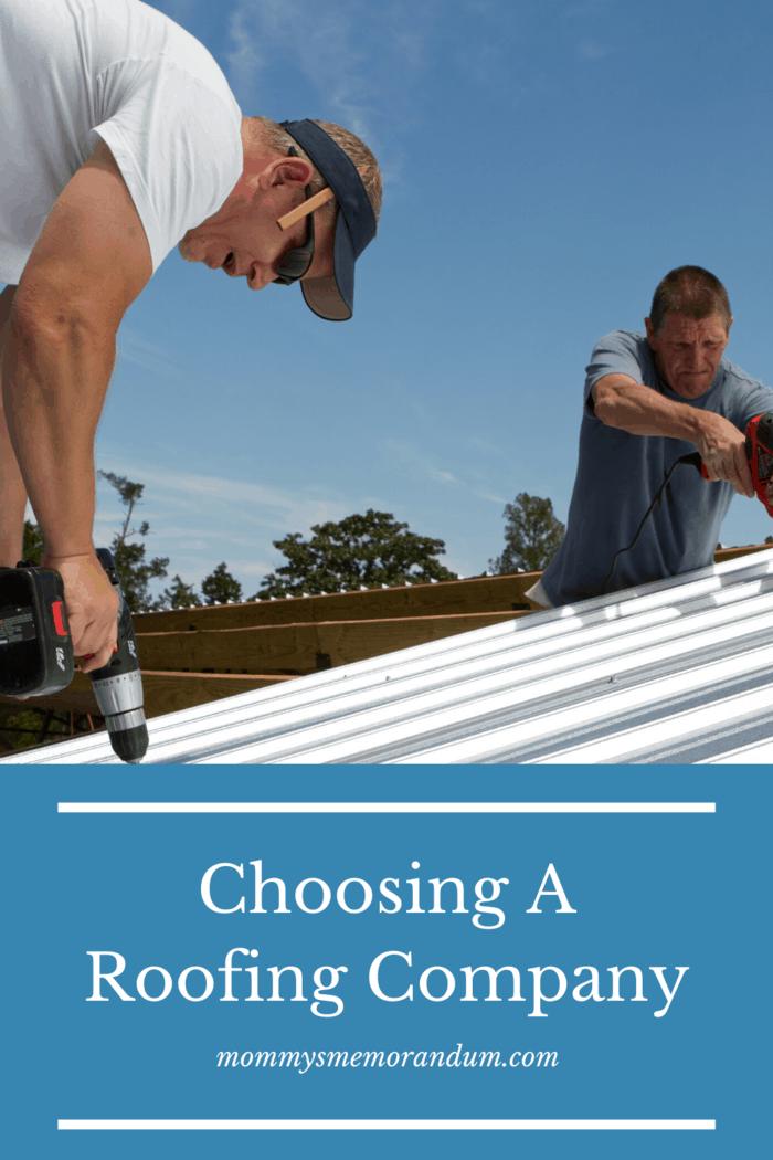 working crew installing metal roof as part of roofing repair