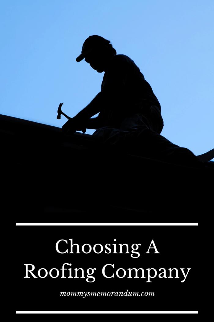 silhouette of man doing roof repair