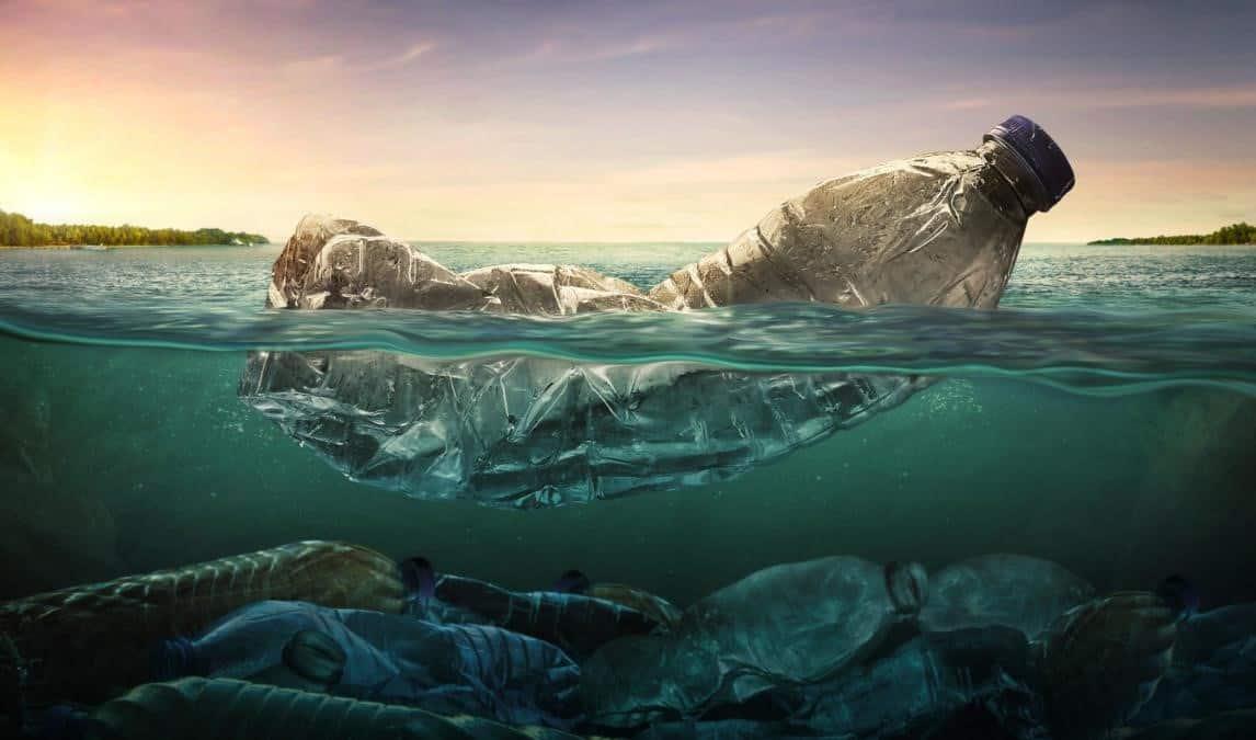plastic waterbottle floating in ocean