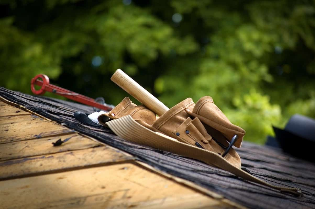 roofing with one side tar and shingled and one side bare wood