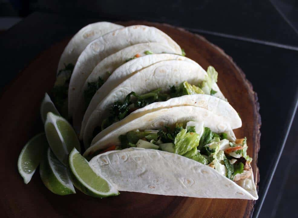 It's always a great night for tacos, right? This seafood-based version plays on traditional Latin American flavors with its fresh cilantro, lime juice, cumin, and smoked paprika.