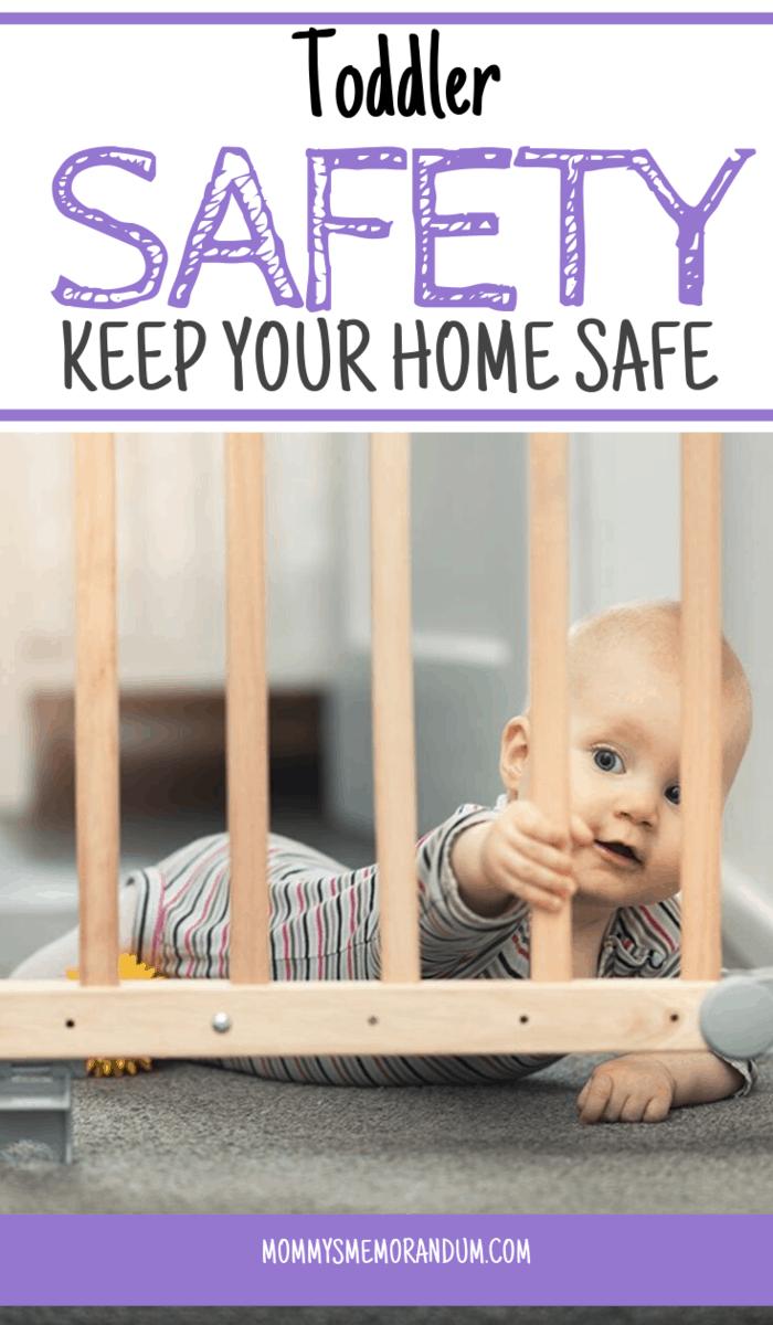 child holding bar of safety gate