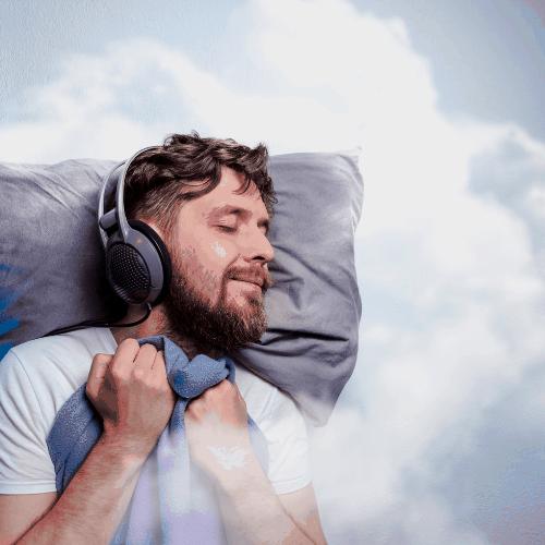Man with headphones, sound asleep, sleeping in clouds