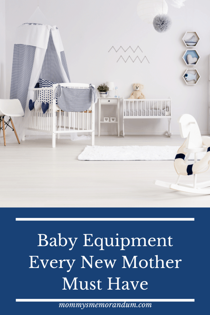 baby nursery in navy and white with baby equipment