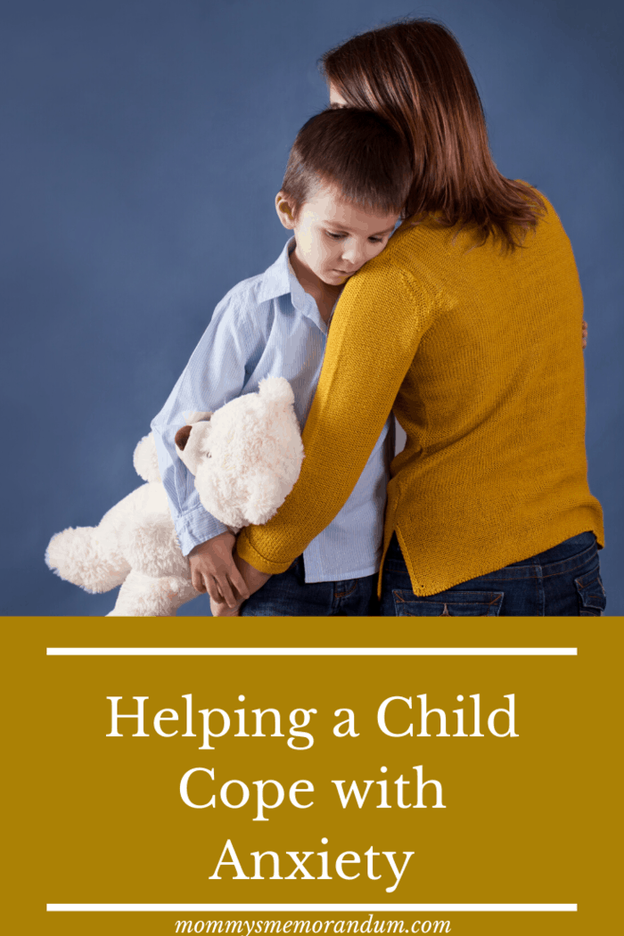 woman in mustard yellow shirt helping a child cope with anxiety