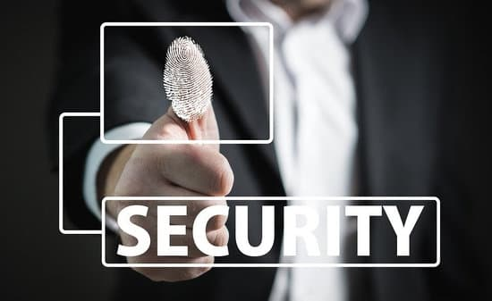 man in suit putting thumb on fingerprint with SECURITY written in front of him