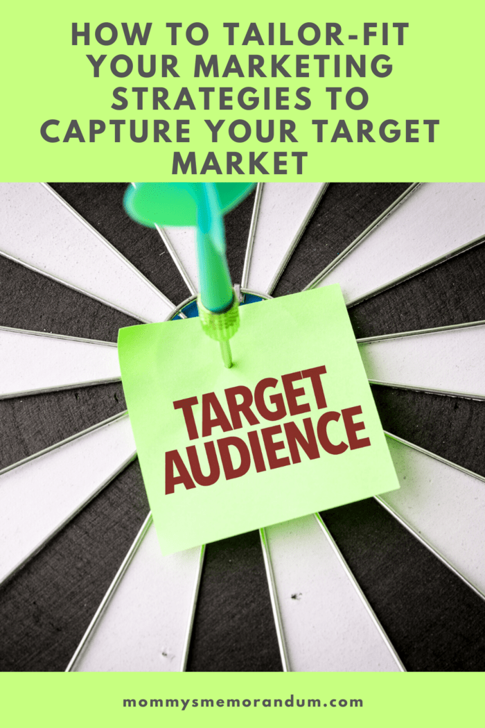 """target with dart in bulls eye holding """"target audience"""" post it"""