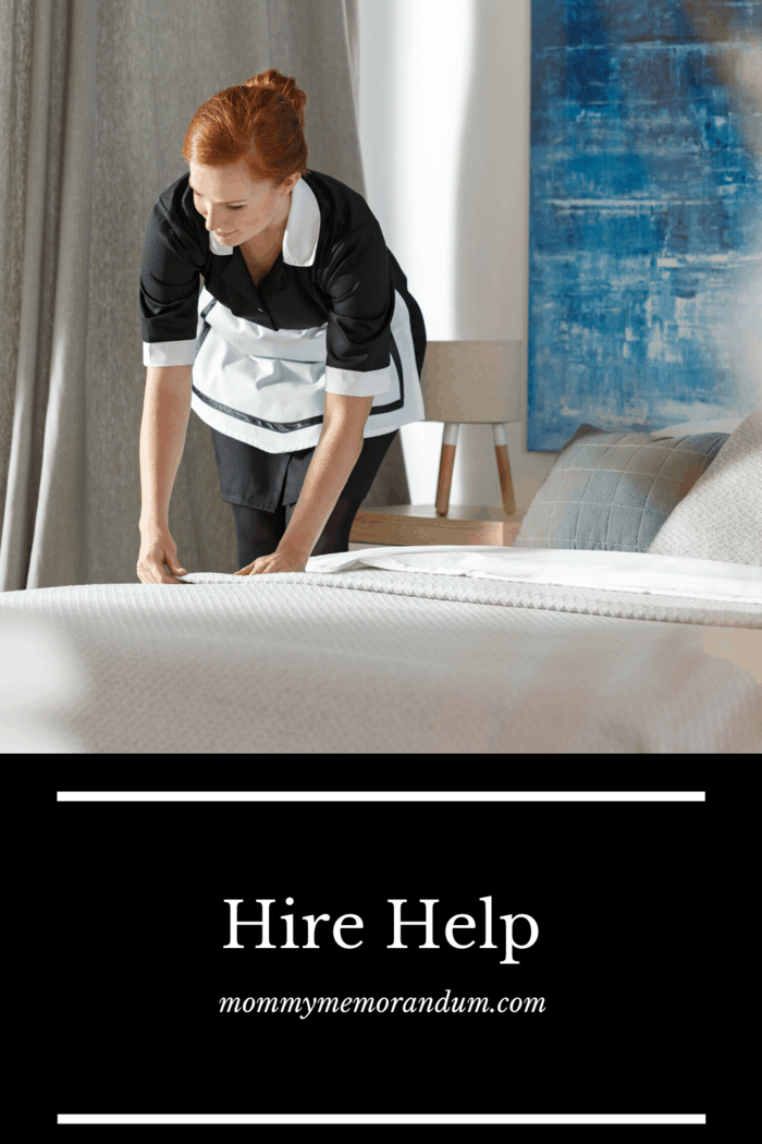 hired maid making bed