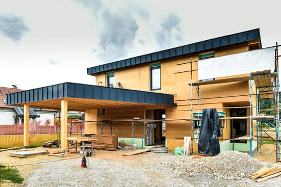 TheBuilding energy efficient passive wooden house. Construction site and exterior of a wooden panel house with scaffolds ready for wall insulation.re are many factors for one to consider before building a house. Before taking the steps to build a house, take these points into consideration: