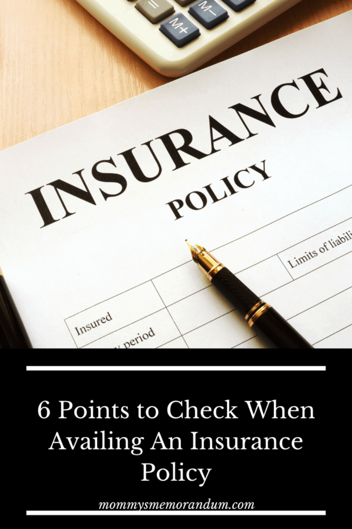 insurance policy on clipboard with pen