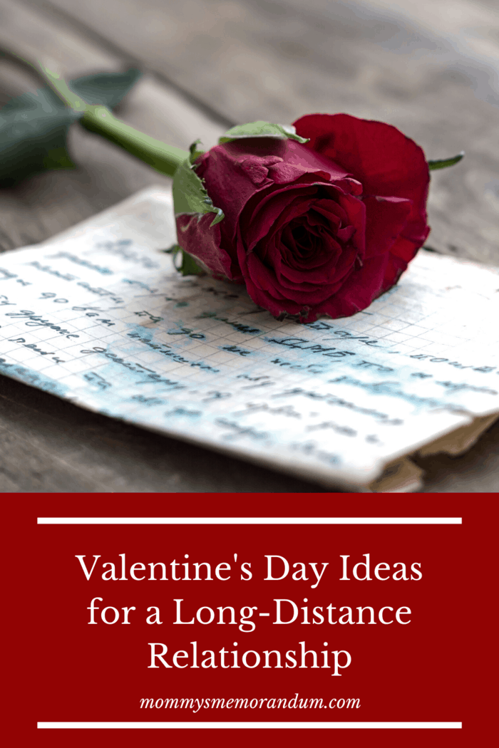 handwritten love letter with single red rose resting on top of letter