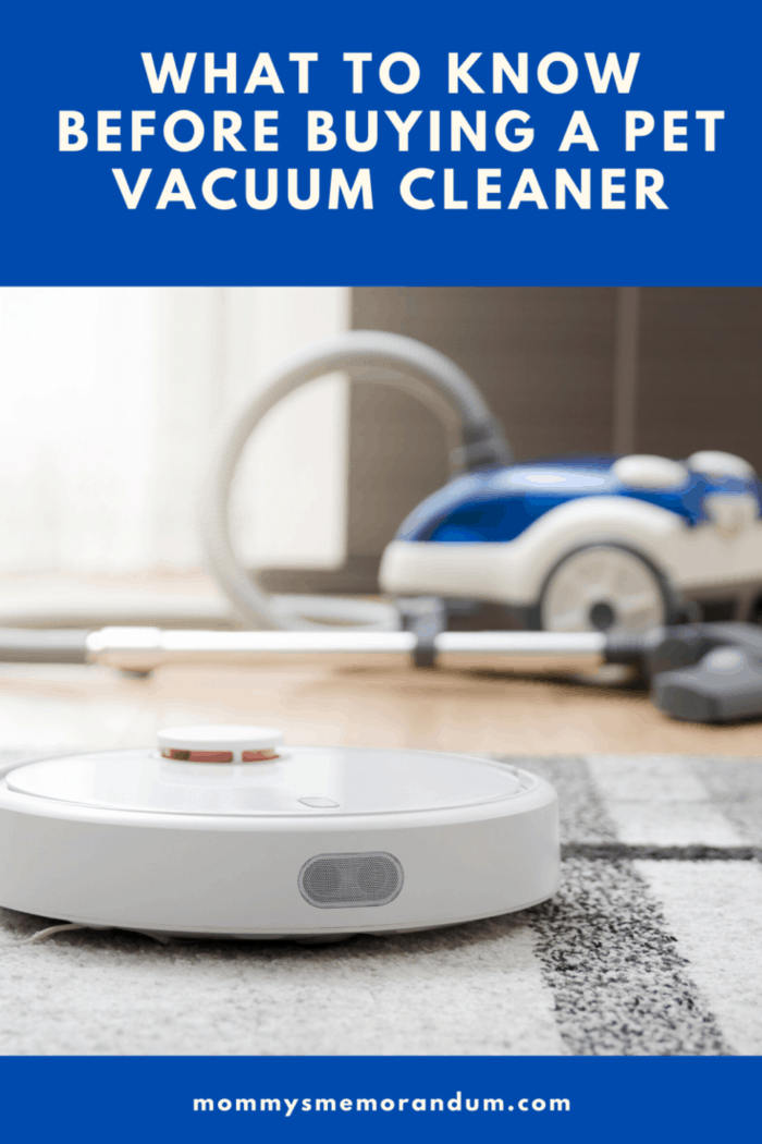 robot vacuum vacuuming with canister background in background
