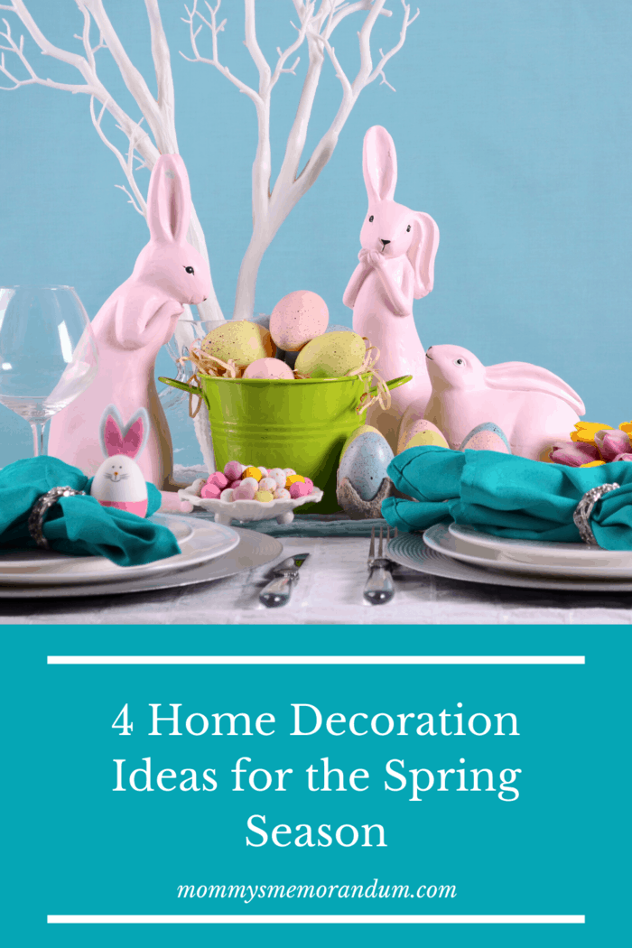 Easter centerpiece with pink rabbits and colored easter eggs.