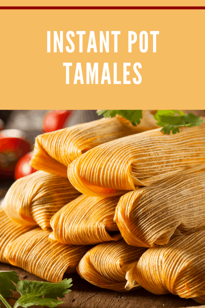 pressure cooker tamales de rajas con queso (cheese tamales with sliced pickled jalapenos) stacked in husks ready to eat