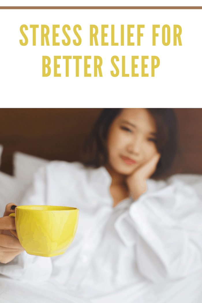 woman in bed with yellow cup of tea