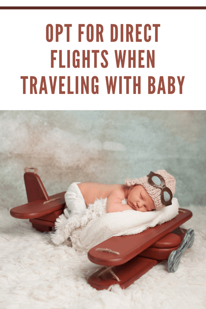 baby dressed as pilot on sleeping on airplane