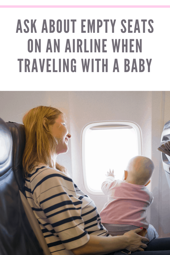 baby on mother's lap on airplane