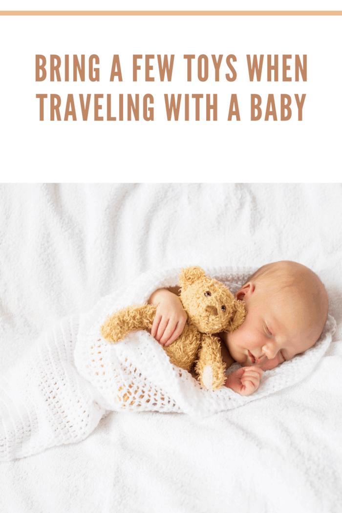 newborn sleeping with teddy bear