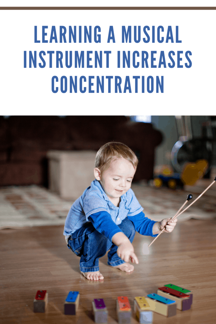 small child playing musical instrument