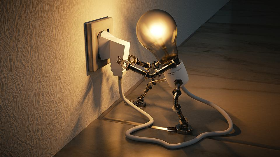 lightbulb light that looks like a man plugging a plug into an outlet