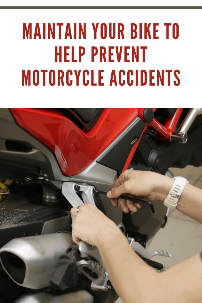 man maintaining motorcycle