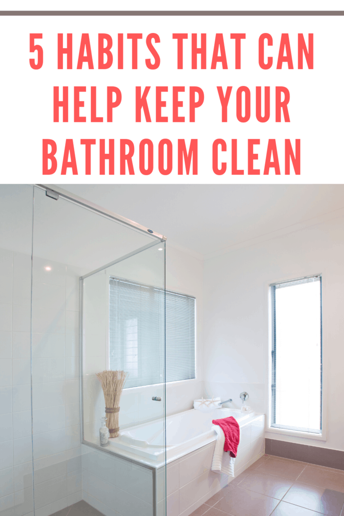 clean bathroom with towels draped over tub