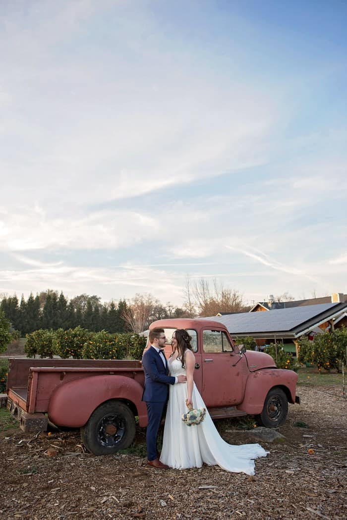 Austin and Kyra in front of an old red truck