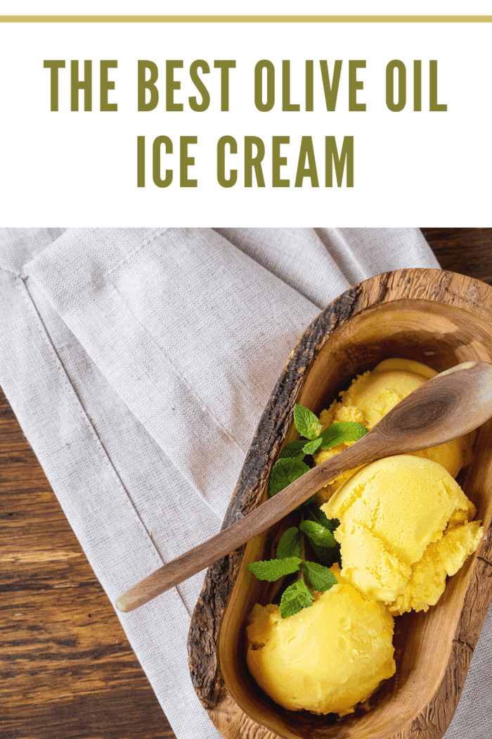 creamy olive oil ice cream scooped into a wooden bowl